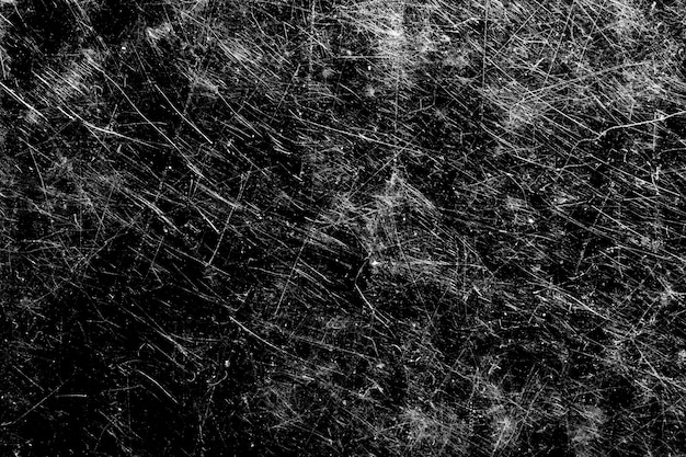 Weiße kratzer auf schwarzem hintergrund. vorlage für design