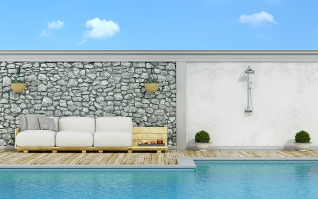 Weiße palettencouch in paletten am pool
