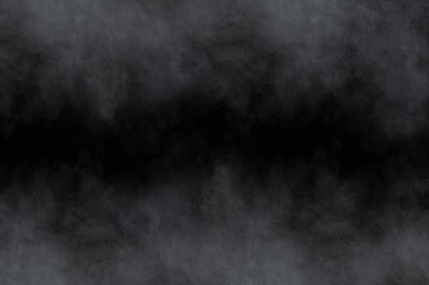Weiße pulverexplosion auf schwarzem hintergrund.