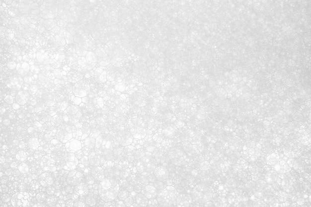 Weiße schaumbeschaffenheitszusammenfassungs-hintergrundnahaufnahme