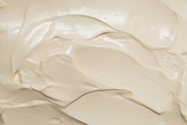 Weiße schlagsahne textur. draufsicht.