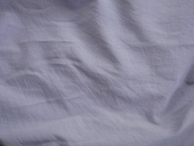 Weiße seidensatinbeschaffenheit, baumwollgewebehintergrund