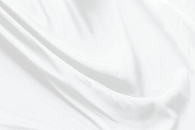 Weiße stoffhintergrundzusammenfassung mit weichen wellen.