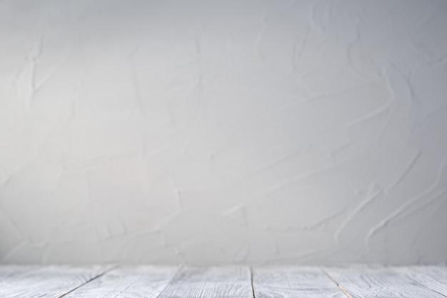 Weiße tischplatte mit grauem hintergrund