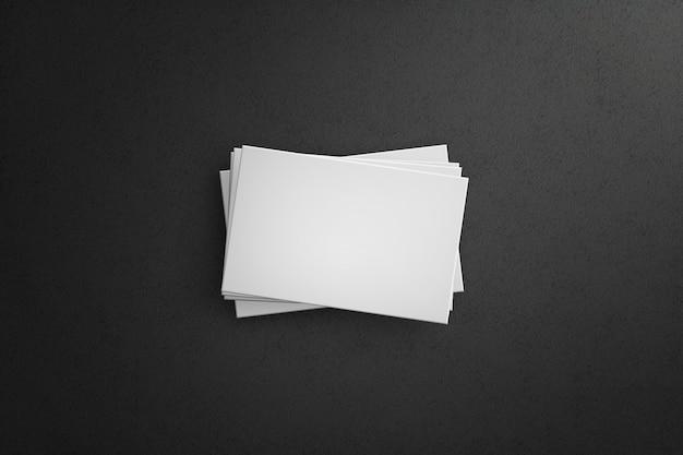 Weiße visitenkarten lokalisiert mit dunklem hintergrund