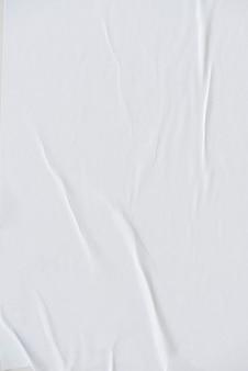 Weiße zerknitterte papierstruktur