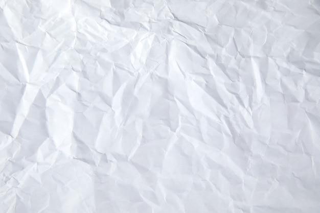 Weiße zerknitterte papierstrukturoberfläche.