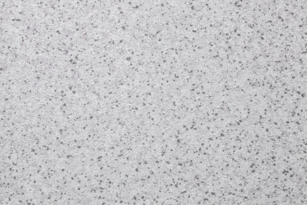 Weißer abstrakter kunsthintergrund. aquarellmalerei mit grauen flecken. textur silberner hintergrund.