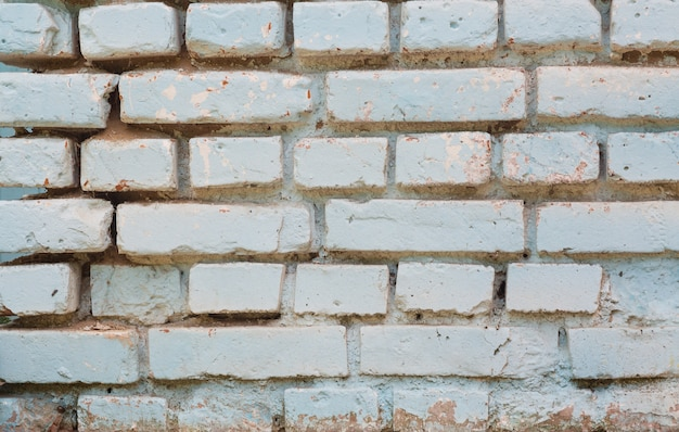 Weißer alter backsteinmauerbeschaffenheitshintergrund