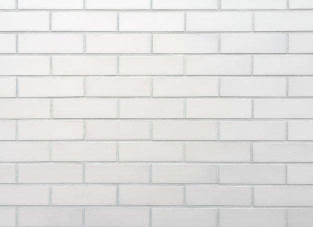Weißer backsteinmauerhintergrund.