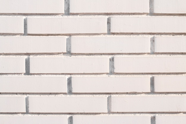 Weißer backsteinmauerhintergrund