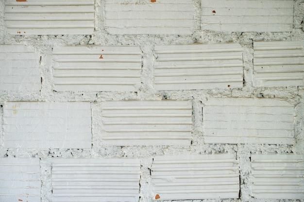 Weißer backsteinmauertexturhintergrund