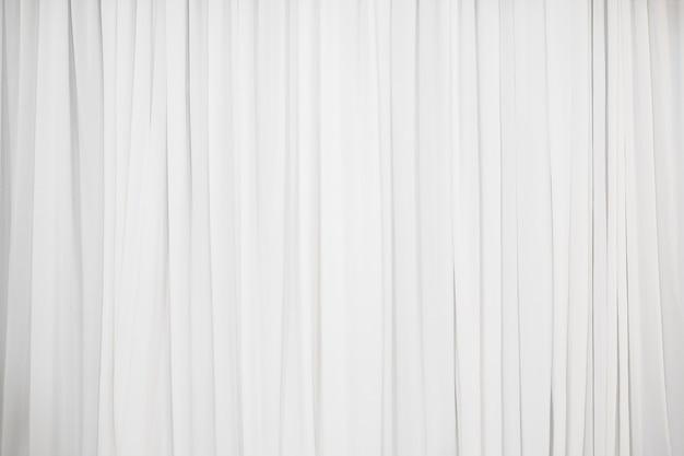 Weißer faltenstoffhintergrund zur dekoration