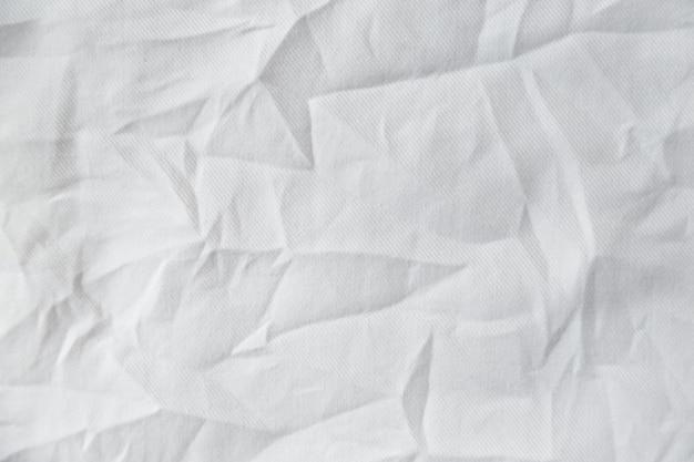 Weißer faltiger leinwandtuchtexturhintergrund