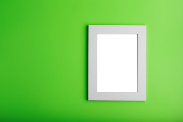 Weißer fotorahmen auf grüner oberfläche