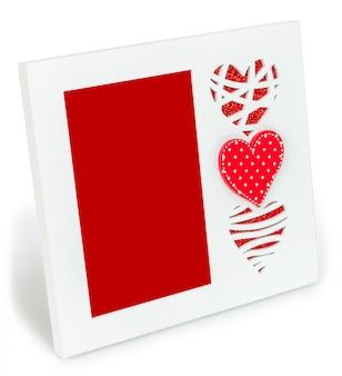 Weißer fotorahmen mit roten herzen