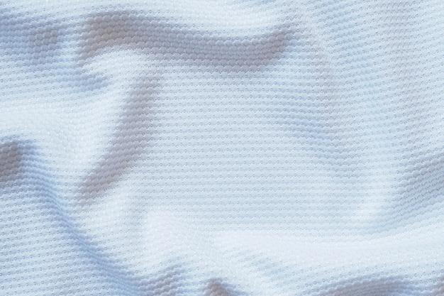 Weißer fußball jersey kleidung stoff textur sportbekleidung hintergrund, nahaufnahme