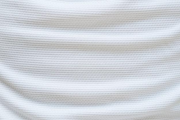 Weißer fußballtrikotkleidungstextur-sportabnutzungshintergrund, nahaufnahme