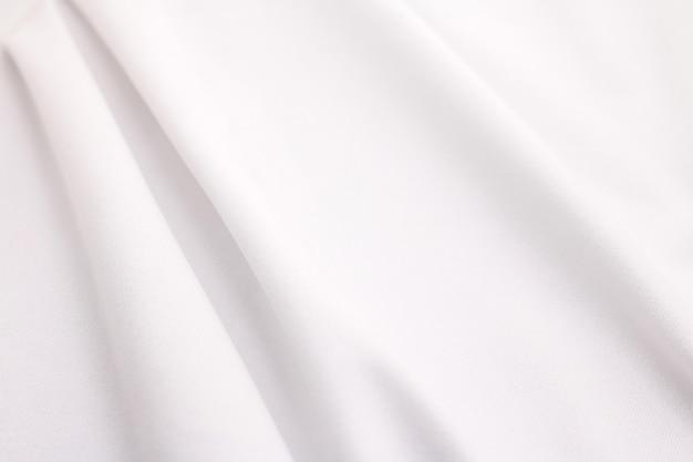 Weißer gewebebeschaffenheitshintergrund. abstraktes tuchmaterial.