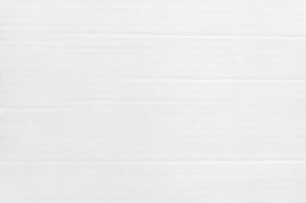 Weißer grauer pappblatt-zusammenfassungshintergrund, beschaffenheit des recyclingpapierkastens im alten weinlesemuster für designkunstwerk.