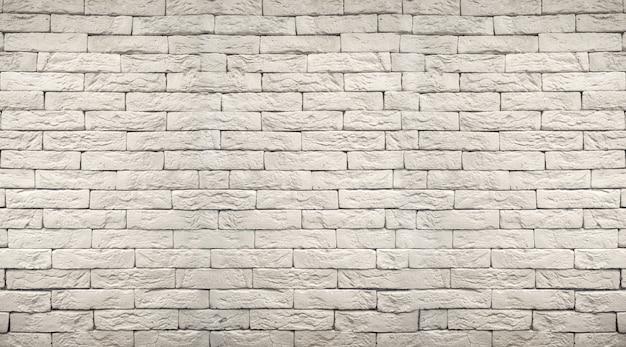 Weißer grauer schmutz-backsteinmauerhintergrund