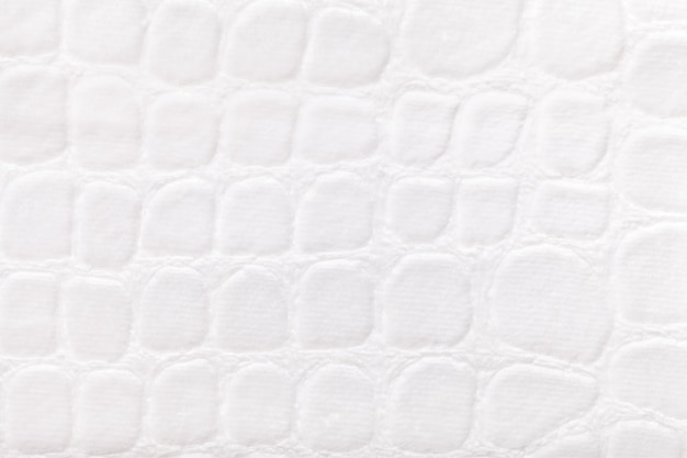 Weißer hintergrund vom weichen polstergewebe, nahaufnahme