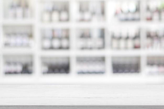 Weißer hölzerner tischplatte-empfangs-zähler oder bargeld-zähler-restaurant oder kaffeecafé verwischten schaukastenhintergrund für das vorhandene montageprodukt