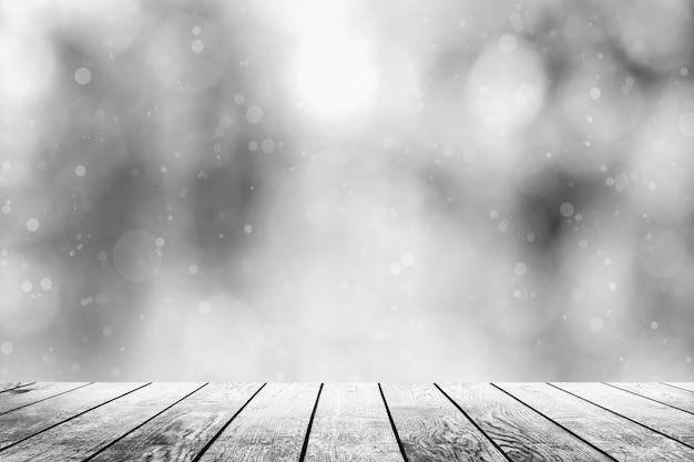 Weißer holztisch auf einem winterhintergrund