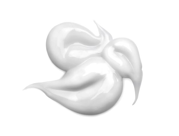 Weißer kosmetischer cremeabstrich isoliert auf weiß