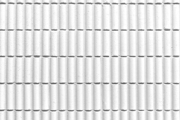 Weißer musterbetonmauerbeschaffenheitshintergrund