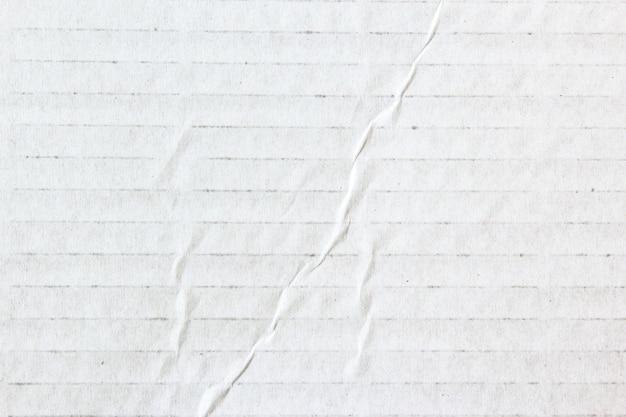 Weißer papiertexturhintergrund oder kartonoberfläche aus einer pappschachtel zum verpacken für die designs