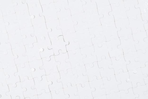 Weißer puzzle-hintergrund.