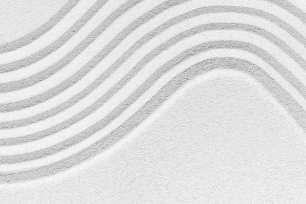 Weißer sand oberflächenstruktur hintergrund zen und friedenskonzept