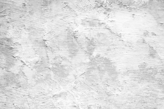 Weißer schmutzbetonmauer-beschaffenheitshintergrund.