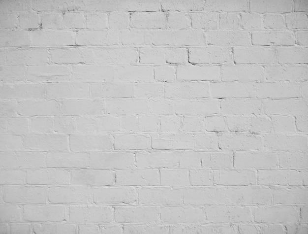 Weißer schmutzhintergrund der alten backsteinmauerbeschaffenheit mit der empfindlichen vignettierung.
