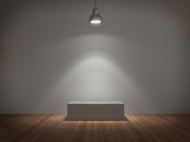 Weißer sockel, beleuchtet von einer lampe für produktausstellung in einem betonraum