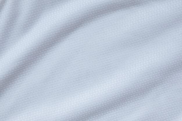 Weißer sportbekleidungsstoff fußballhemd jersey textur hintergrund
