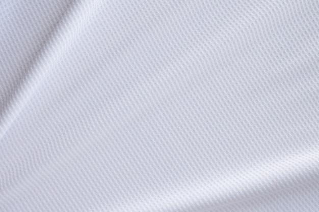 Weißer sportbekleidungsstoff fußballtrikot trikot textur abstrakter hintergrund