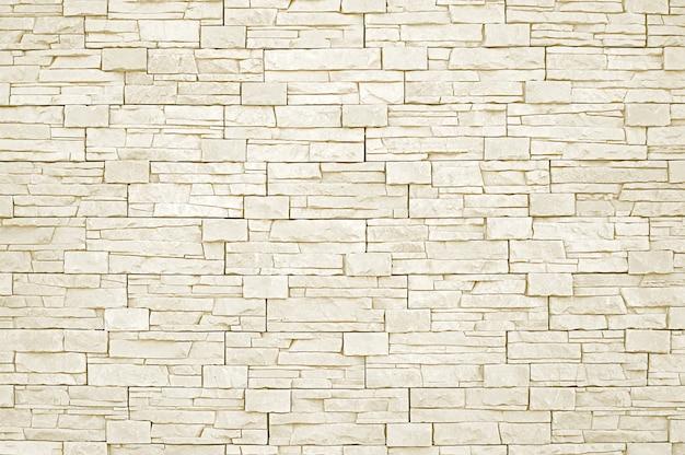 Weißer steinmosaikwandhintergrund