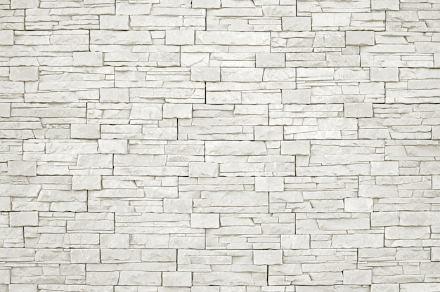 Weißer steinwandhintergrund