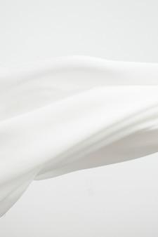 Weißer stoffbeschaffenheitshintergrund