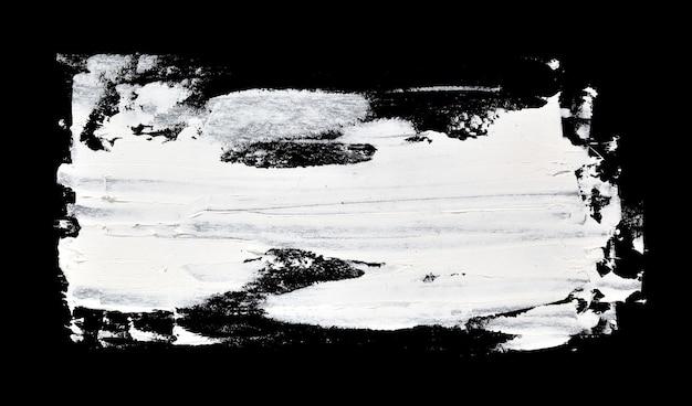 Weißer streifen. grunge pinselstriche von ölfarbe auf schwarzem hintergrund
