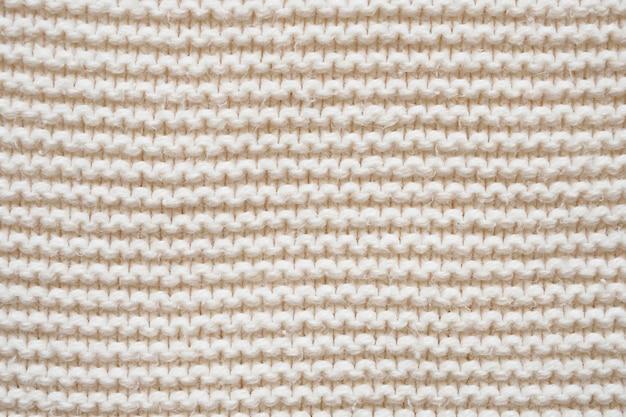 Weißer strickwolltexturhintergrund