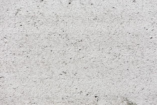 Weißer stuckwandhintergrund. weiß gemalte zementwandbeschaffenheit