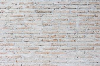 Weißer und brauner Backsteinmauerhintergrund, Hintergrund der alten Weinlesewand mit Schalenputz