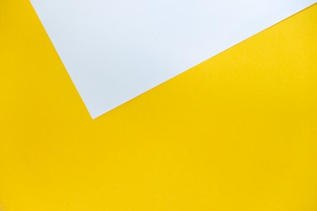 Weißer und gelber farbpapierbeschaffenheitshintergrund