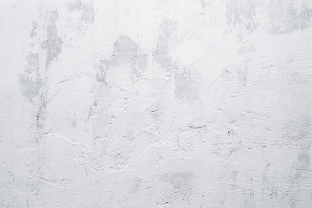Weißer wandhintergrund des alten schmutzes. textur der gealterten weiß getünchten wand