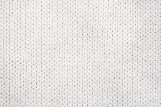Weißer wollstrickjacke-beschaffenheitshintergrund