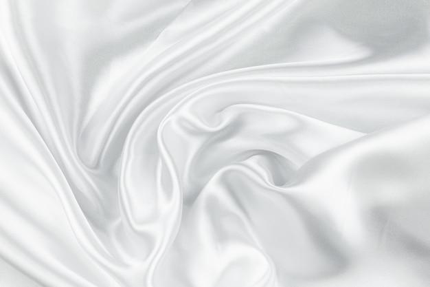 Weißer zerknitterter hintergrund der stoffstruktur
