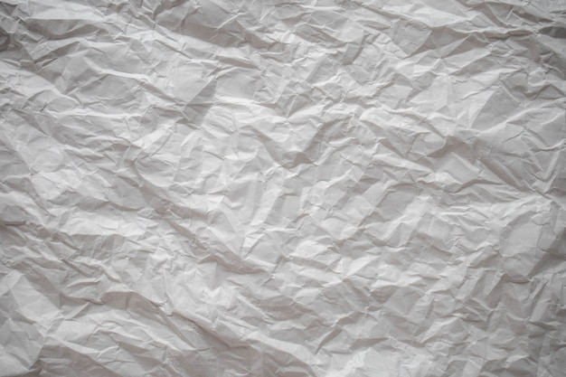 Weißer zerknitterter papierabschluß herauf beschaffenheitshintergrund